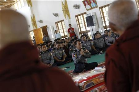 Police Sagaing Division Chief San Yuu prays and explains to Buddhist monks during an apology ceremony at a temple in Monywa December 1, 2012. REUTERS/Soe Zeya Tun