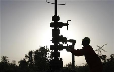 A technician opens a pressure gas valve inside the Oil and Natural Gas Corp (ONGC) group gathering station on the outskirts of the western Indian city of Ahmedabad March 2, 2012. REUTERS/Amit Dave/Files
