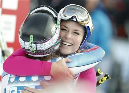Lindsey Vonn (R) of the U.S. embraces Laurenne Ross of the U.S. in the finish area after the women's Alpine skiing World Cup Super-G race at the Corviglia in the Swiss mountain resort of St. Moritz December 8, 2012. REUTERS/Michael Buholzer