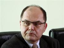 State secretary Christian Schmidt, who deputises outgoing Defence Minister Karl-Theodor zu Guttenberg, attends a cabinet meeting at the Chancellery in Berlin, March 2, 2011. REUTERS/Thomas Peter