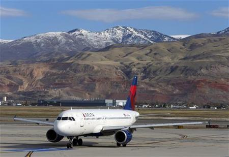 A Delta Airlines Airbus A320 passenger jet taxis, a day before the annual Thanksgiving Day holiday, at the Salt Lake City international airport, in Salt Lake City, Utah, November 21, 2012. REUTERS/George Frey