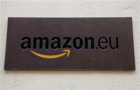 The logo of Amazon Europe Holding Technologies is seen at its entrance in Luxembourg in this picture taken on November 20, 2012. To match Special Report TAX-AMAZON/ REUTERS/Francois Lenoir