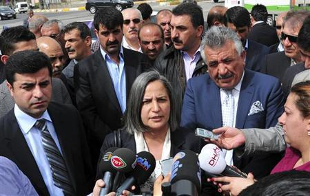 Peace and Democracy Party (BDP) Parliamentarian Gultan Kisanak (C), accompanied by her party's co-chairman Selahattin Demirtas (L) and Siirt Mayor Selim Sadak, speaks to the media in Diyarbakir, southeastern Turkey, April 19, 2011. REUTERS/Stringer