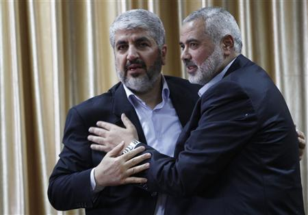 Senior Hamas leader Ismail Haniyeh (R) hugs Hamas chief Khaled Meshaal as he cries upon Meshaal's arrival at the Rafah crossing in the southern Gaza Strip December 7, 2012. Meshaal ended decades of exile from Palestinian land on Friday with a triumphal first ever visit to the Gaza Strip that underscored the Islamist group's growing confidence following its latest conflict with Israel. REUTERS/Ahmed Jadallah