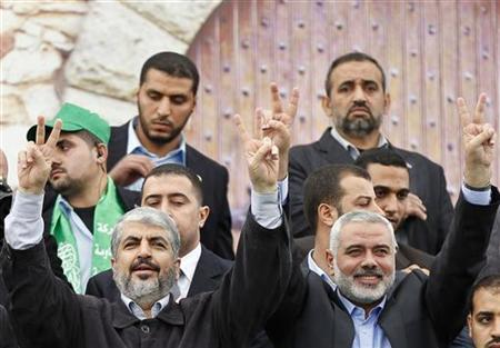 Hamas chief Khaled Meshaal (L) and senior Hamas leader Ismail Haniyeh flash victory signs upon arrival at a rally marking the 25th anniversary of the founding of Hamas, in Gaza City December 8, 2012. REUTERS/Mohammed Salem