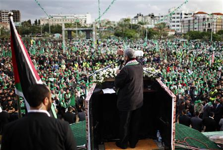 Hamas chief Khaled Meshaal gives a speech during a rally marking the 25th anniversary of the founding of Hamas, in Gaza City December 8, 2012. REUTERS/Ahmed Jadallah