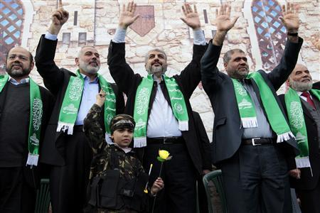 Hamas chief Khaled Meshaal (C) and senior Hamas leaders wave to the crowd during a rally marking the 25th anniversary of the founding of Hamas, in Gaza City December 8, 2012. REUTERS/Ahmed Jadallah