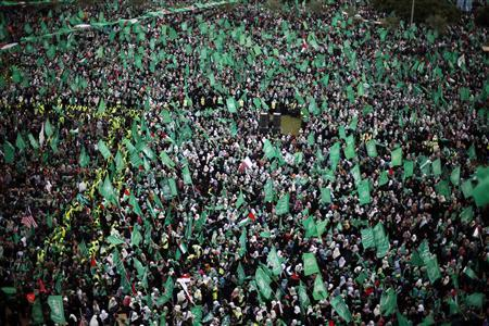 Palestinians take part in a rally marking the 25th anniversary of the founding of Hamas, in Gaza City December 8, 2012. REUTERS/Suhaib Salem