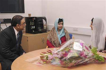 Pakistan's President Asif Zardari meets with schoolgirl Malala Yousufzai (C) during his visit to the Queen Elizabeth Hospital in Birmingham, central England December 8, 2012. Yousufzai, who was shot in the head at close range by the Pakistan Taliban in October as she left school in the Swat valley, was flown for specialist treatment at the hospital which has treated hundreds of British soldiers wounded in Afghanistan. REUTERS/Queen Elizabeth Hospital/Handout