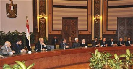 Egypt's President Mohamed Mursi (4th L) attends a meeting with Egypt's Vice President Mahmoud Mekky (3rd L) and other politicians and heads of parties at the presidential palace in Cairo December 8, 2012. REUTERS/Egyptian Presidency/Handout