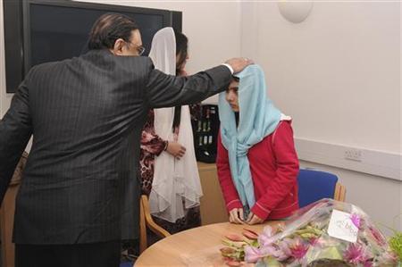 Pakistan's President Asif Zardari meets with schoolgirl Malala Yousufzai (R) during his visit to the Queen Elizabeth Hospital in Birmingham, central England December 8, 2012. REUTERS/Queen Elizabeth Hospital/Handout