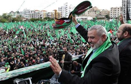 Senior Hamas leader Ismail Haniyeh waves to the crowd during a rally marking the 25th anniversary of the founding of Hamas, in Gaza City December 8, 2012. REUTERS/Ahmed Jadallah