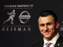 Texas A&M quarterback Johnny Manziel looks on during a news conference after winning the Heisman Trophy award in New York December 8, 2012. Manziel was awarded the Heisman Trophy on Saturday, making him the first 'freshman' to win college football's top honour. REUTERS/Adam Hunger