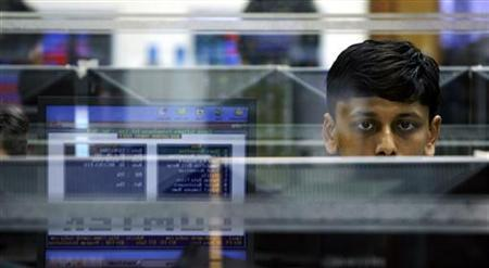 A trader looks at a screen at a stock brokerage firm in Mumbai March 13, 2008. REUTERS/Arko Datta/Files