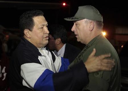 Venezuela's President Hugo Chavez (L) talks to Venezuela's Defense Minister Admiral Diego Molero, upon his arrival from Cuba, at Simon Bolivar airport in Caracas December 7, 2012. REUTERS/Miraflores Palace/Handout