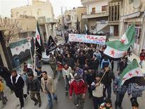 """Demonstrators hold a banner during a protest against Syria's President Bashar al-Assad after Friday prayers in Binish, near Idlib, December 7, 2012. The banner reads: """"No to peacekeepers in Syria"""". REUTERS/Hamzeh Al-Binishi/Shaam News Network/Handout"""