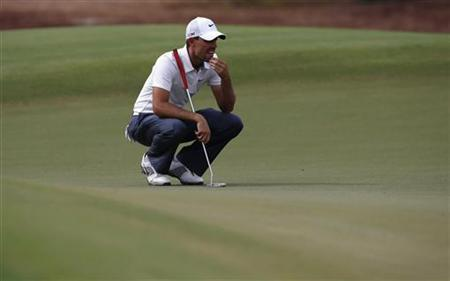 Charl Schwartzel of South Africa lines up his shot on the first green during the third round of the DP World Tour Championship at Jumeirah Golf Estates in Dubai November 24, 2012. REUTERS/Jumana El Heloueh/Files