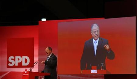 Designated top candidate of the German Social Democratic Party (SPD) for the 2013 German general elections, Peer Steinbrueck delivers his speech during the extraordinary party meeting of the SPD in Hanover, December 9, 2012. More than 500 delegates are supposed to elect Peer Steinbrueck as the SPD's top candidate for Germany's 2013 general elections. REUTERS/Kai Pfaffenbach (GERMANY - Tags: POLITICS)