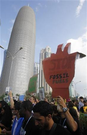 Local and foreign activists march to demand for action to address climate change in Doha December 1, 2012. The first U.N. climate negotiations ever held in the Middle East will be taking place until December 7. According to local media, the march is thought to be the first ever event of its kind in the history of modern-day Qatar, and activists from across the Arab region will be calling on their own leaders to pledge to reduce their emissions by 2020. REUTERS/Mohammed Dabbous (QATAR - Tags: ENVIRONMENT CIVIL UNREST POLITICS)
