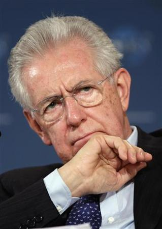 Italy's Prime Minister Mario Monti gestures at the World Policy Conference in Cannes December 8, 2012. The World Policy Conference is devoted to the issue of global governance in all its aspects and takes place from December 7 to 10. REUTERS/Eric Gaillard (FRANCE - Tags: POLITICS)