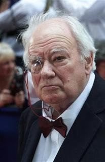 File photo of British astronomer Patrick Moore arriving for the British Academy television awards at the Grosvenor House hotel London May 13, 2001. MC