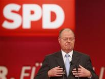 Designated top candidate of the German Social Democratic Party (SPD) for the 2013 German general elections, Peer Steinbrueck speaks during the extraordinary party meeting of the SPD in Hanover, December 9, 2012. Steinbrueck on Sunday was elected as the SPD's top candidate for Germany's 2013 general elections. REUTERS/Ralph Orlowski