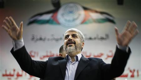 Hamas chief Khaled Meshaal waves to Palestinian student during his visit to the Islamic University in Gaza City December 9, 2012. REUTERS/Suhaib Salem