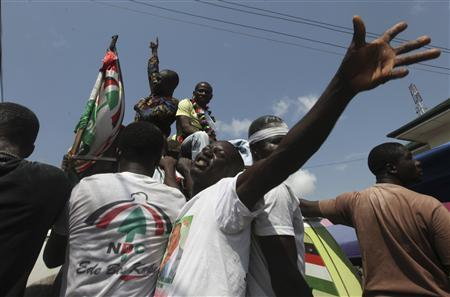 Supporters of National Democratic Congress (NDC) celebrate the victory of their candidate, John Dramani Mahama, on a street in Accra December 9, 2012. Ghana's main opposition party said on Sunday the country's presidential election had been manipulated, raising concerns about the outcome of the poll in a nation seen as a bulwark of democracy in an unstable region. REUTERS/Luc Gnago