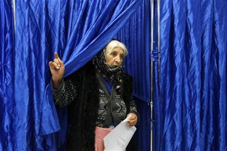 A woman leaves a polling booth at a voting station during elections for Romania's Parliament in Pantelimon, near Bucharest December 9, 2012. REUTERS/Bogdan Cristel