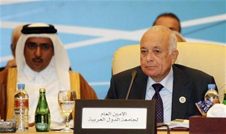 Arab League Secretary-General Nabil Elaraby (R) attends the Arab Peace Initiative Committee Meeting in Doha December 9, 2012. REUTERS/Mohammed Dabbous