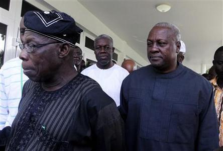 John Dramani Mahama (R), Ghana's interim president and the National Democratic Congress (NDC) presidential candidate, walks behind former Nigerian president Olusegun Obasanjo (L), also head of the Economic Community of West African States (ECOWAS) Observation Mission to Ghana, at Mahama's home in Accra December 9, 2012. REUTERS/Luc Gnago