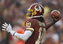 Washington Redskins quarterback Robert Griffin III passes against the Baltimore Ravens in the second half of their NFL football game in Landover, Maryland December 9, 2012. REUTERS/Gary Cameron