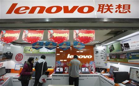 Customers talk to a salesperson about a new laptop at a Lenovo shop in Shanghai February 17, 2011. REUTERS/Aly Song