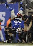 New York Giants' running back David Wilson does a back flip after running for a touchdown in the fourth quarter against the New Orleans Saints in their NFL football game in East Rutherford, New Jersey, December 9, 2012. REUTERS/Mike Segar