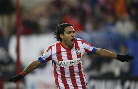 Atletico Madrid's Radamel Falcao celebrates his goal against Deportivo La Coruna during their Spanish first division soccer match at Vicente Calderon stadium in Madrid December 9, 2012. REUTERS/Susana Vera