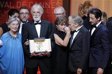 Director Michael Haneke (2ndL), actress Emmanuelle Riva (L) and actor Jean-Louis Trintignant (2ndR) react after receiving the Palme d'Or award for the film ''Amour'' (Love) during the awards ceremony of the 65th Cannes Film Festival, May 27, 2012. REUTERS/Eric Gaillard