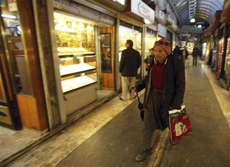 A man walks past a jewellery shop in a market in the southeastern city of Sanliurfa November 27, 2012. REUTERS/Amr Abdallah Dalsh/Files