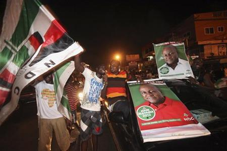 Supporters of National Democratic Congress (NDC), the party of the late Ghanaian President John Atta Mills, celebrate the victory of their candidate, John Dramani Mahama, along a street in Accra December 9, 2012. REUTERS/Luc Gnago