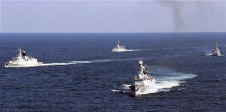 Vessels roam the waters of the East China Sea during a naval exercise, October 19, 2012. REUTERS/China Daily/Files