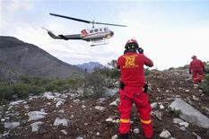Civil Protection personnel inspect the perimeter of the crash site of a plane with Mexican-American singer Jenni Rivera on board, in the municipality of Iturbide, south of Monterrey December 9, 2012. Rivera died in a plane crash after the small jet she was travelling in went down in northern Mexico, her father said on Sunday. Speaking after the wreckage was discovered, the singer's father, Pedro Rivera, told Telemundo television all seven of the people on board the plane, including two pilots, had died. REUTERS/Stringer