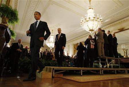President Barack Obama and Vice President Joe Biden walk from the stage, following remarks on the impending ''fiscal cliff'' talks with Congress, in the East Room of the White House in Washington, November 9, 2012. REUTERS/Jason Reed