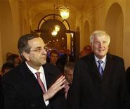 Greek Prime Minister Antonis Samaras (L) is welcomed by Horst Seehofer, Prime Minister and leader of the Christian Social Union (CSU) during a visit in Munich December 9, 2012. REUTERS/Michaela Rehle