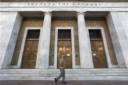 An elderly man walks outside the Bank of Greece in Athens November 9, 2012. Picture taken November 9, 2012. To match Special Report GREECE-CRISIS-PENSIONS REUTERS-Yorgos Karahalis