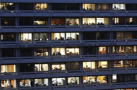 Employees are seen working in their offices in the building housing Greece's finance and development ministries in Athens November 29, 2012. REUTERS-John Kolesidis