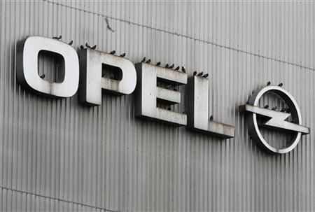 Birds sit on a logo of German car manufacturer Opel at the headquarters in Ruesselsheim November 12, 2012. REUTERS/Lisi Niesner
