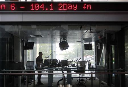 A man works in a studio at the 2Day FM radio station in Sydney December 6, 2012. REUTERS/Daniel Munoz