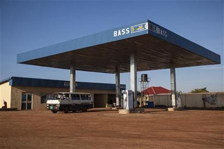 A matatu taxi driver searches for petrol at a fuel station in Juba October 11, 2012. REUTERS/Adriane Ohanesian/Files