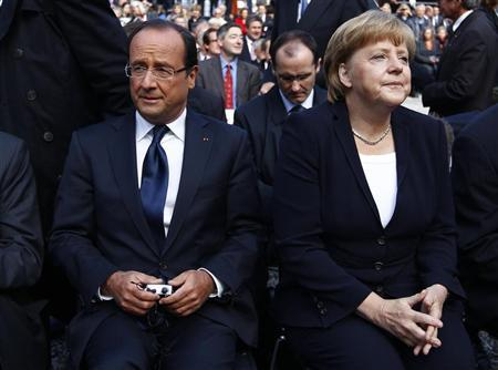 France's President Francois Hollande (L) and Germany's Chancellor Angela Merkel sit together before the 50th anniversary ceremony of the reconciliation speech of France's President Charles de Gaulle to the Germany youth after World War II, in castle Ludwigsburg September 22, 2012. REUTERS/Michaela Rehle