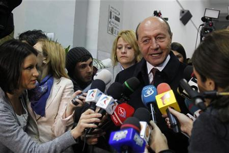 Romania's President Traian Basescu speaks to journalists after voting at a polling station during parliamentary elections in Bucharest December 9, 2012. REUTERS/Bogdan Cristel