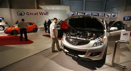 People look at cars of Chinese automaker Great Wall Motor Co Ltd displayed during the Sofia Motor Show 2011 in Sofia June 15, 2011. REUTERS/Stoyan Nenov